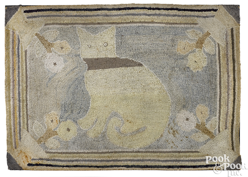 Hooked rug of a cat