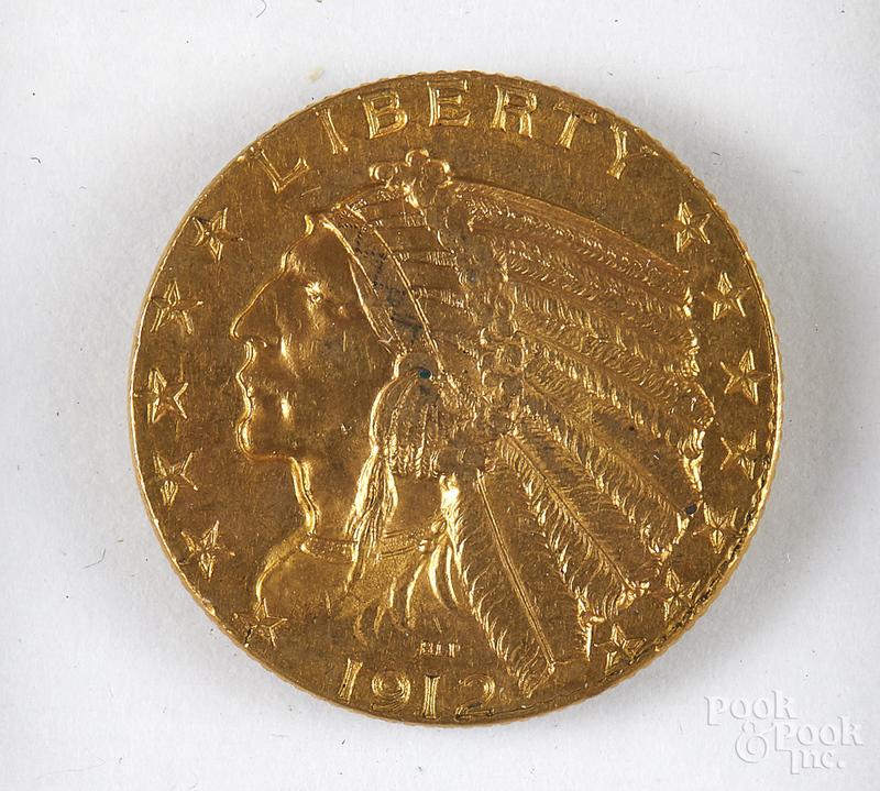 1912 five dollar Indian head gold coin.