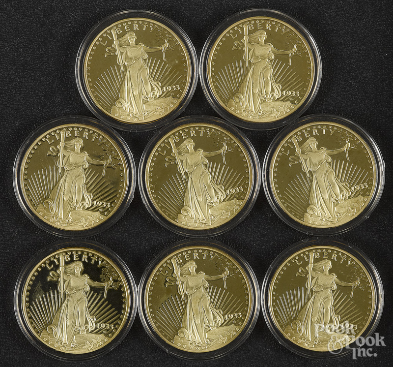 Eight replica 1933 gold double eagle proof coins.