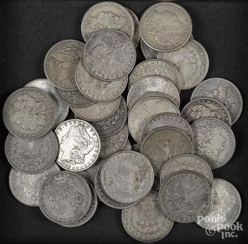 Thirty-seven Morgan silver dollars.