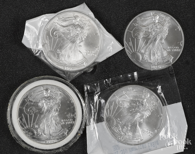 Four American eagle 1 ozt. fine silver coins.