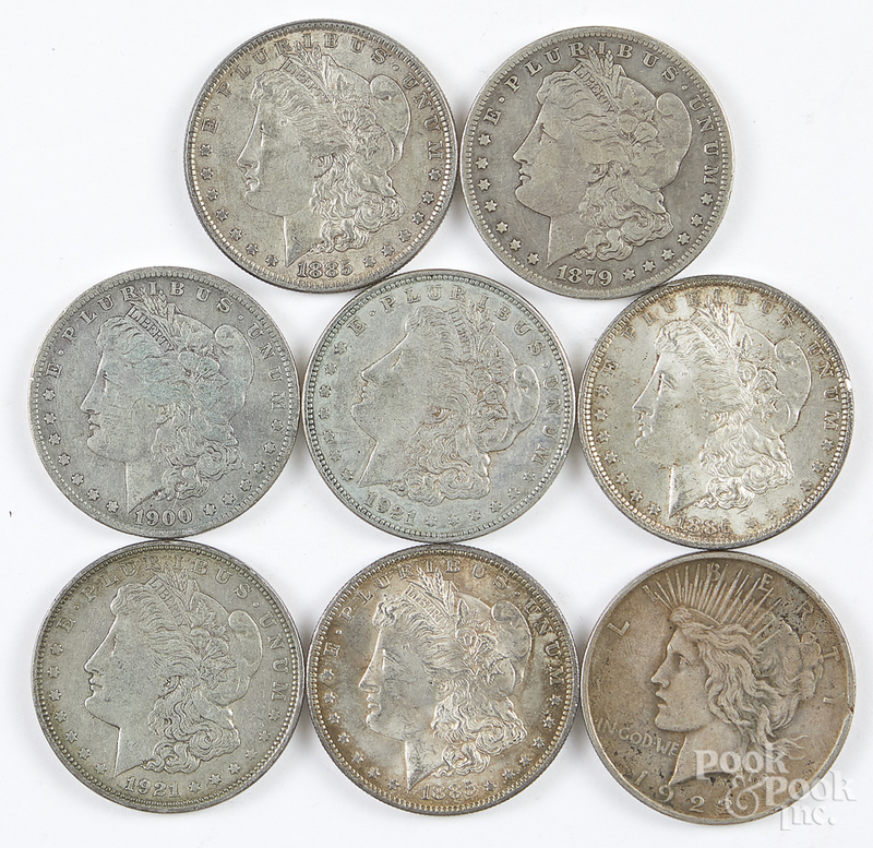 Seven Morgan silver dollars, etc.