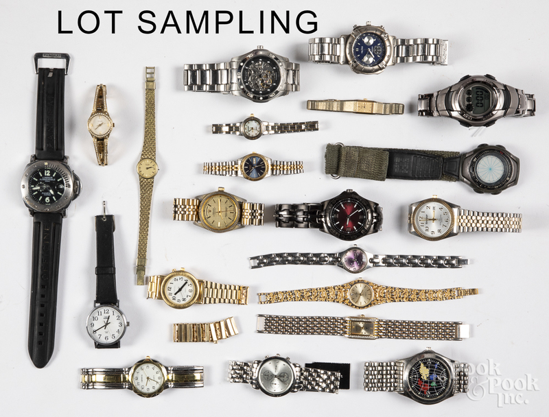 Group of wrist and pocket watches.