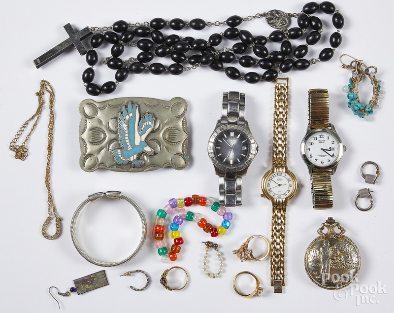 Assorted group of costume jewelry and watches.