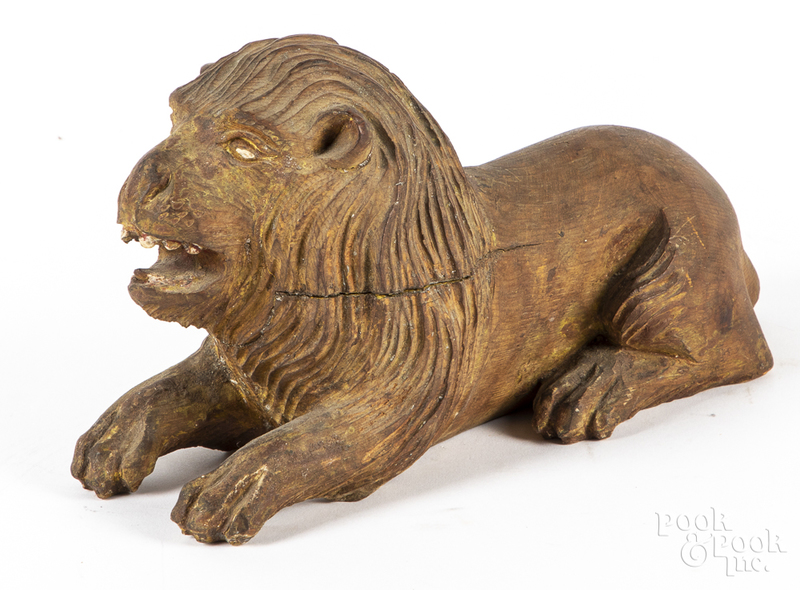 Carved recumbent lion