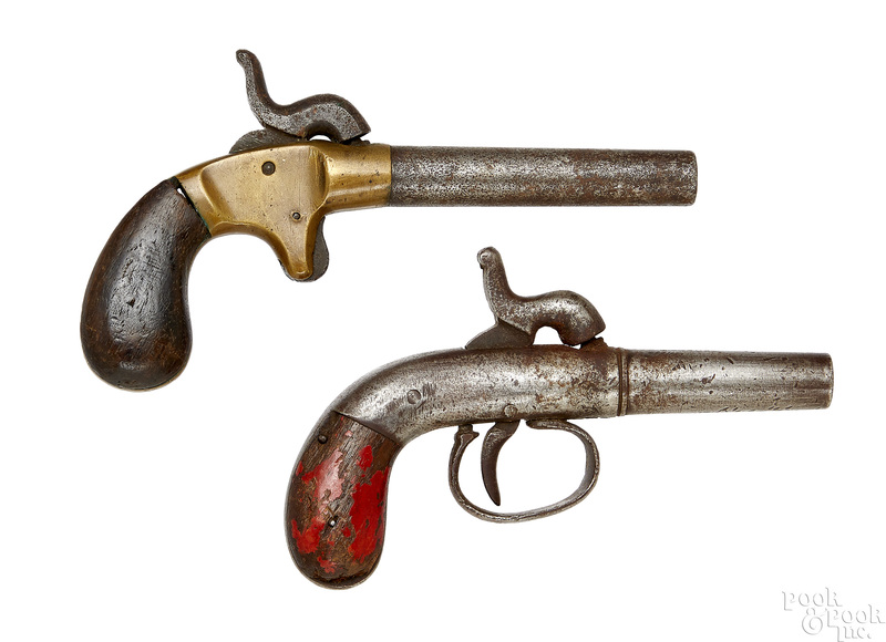 Two single shot percussion pistols