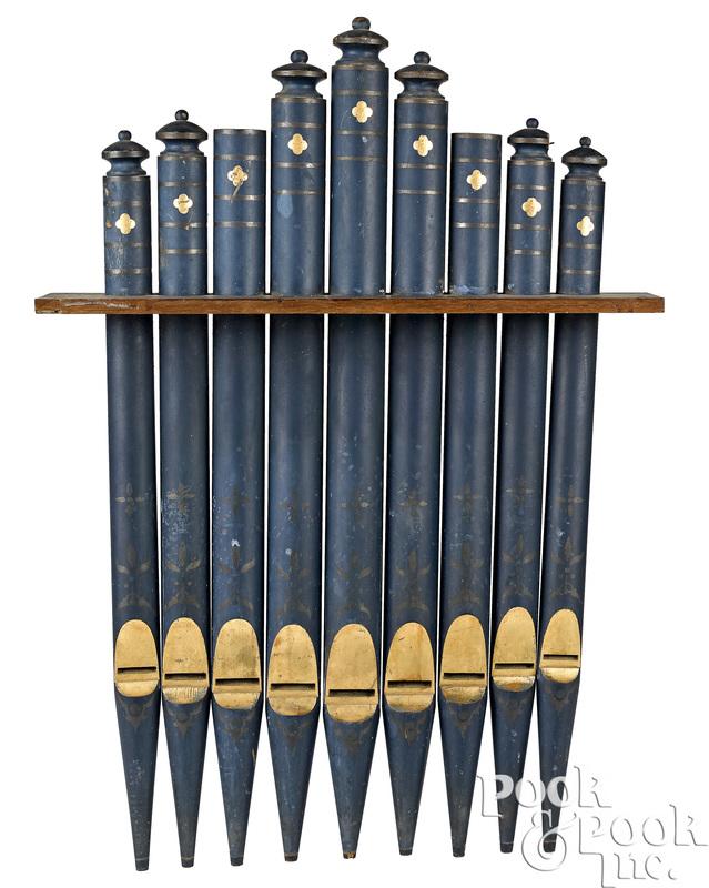 Nine painted wood organ pipes