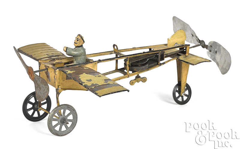 Orobr Bleriot style painted tin clockwork airplane