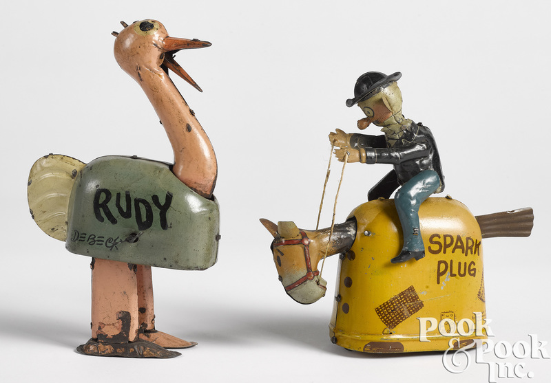 Two Nifty tin lithograph wind-up toys