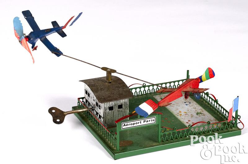 German painted tin Aeroport Paris clockwork toy