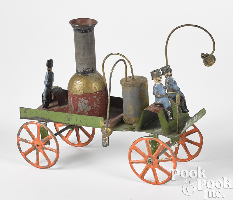 Early painted tin transitional fire pumper