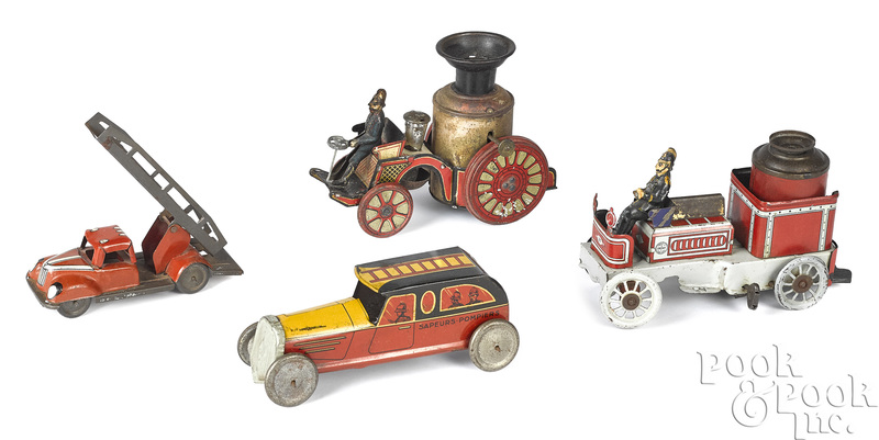 Two tin lithograph fire pumpers, etc.