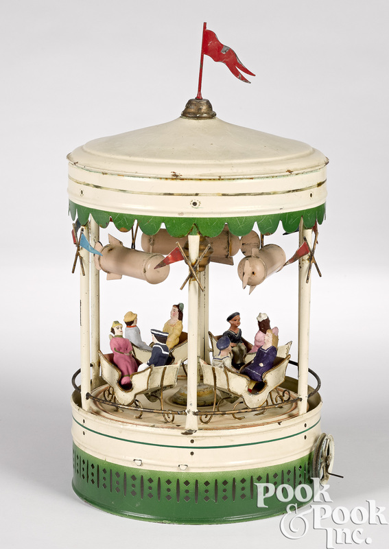 German painted tin carousel with dirigibles