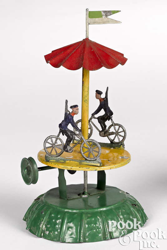 Painted tin cyclist carousel steam toy accessory