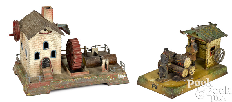 Two painted and embossed tin steam toy accessories