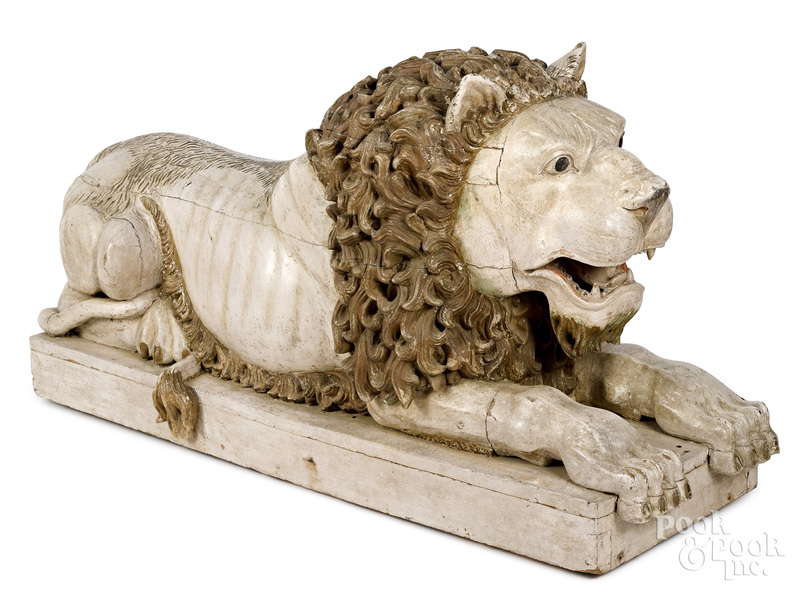 Large carved and painted recumbent lion