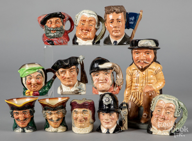 Twelve Royal Doulton toby mugs and pitchers.
