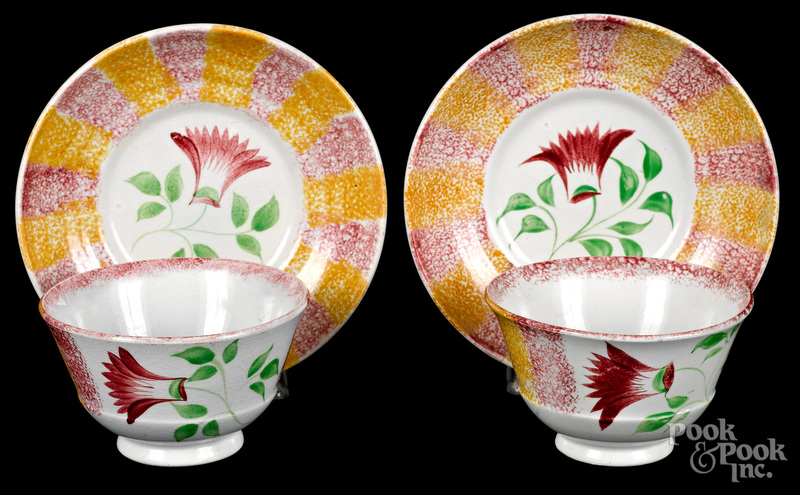 Pair of rainbow spatter cups and saucers