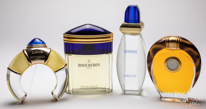 Four glass store display factice perfume bottles