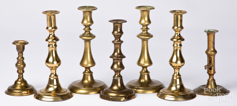 Seven brass candlesticks, etc.