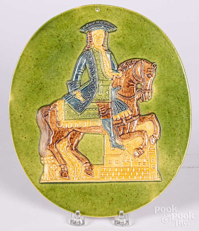 Pottery plaque of a colonial horse and rider
