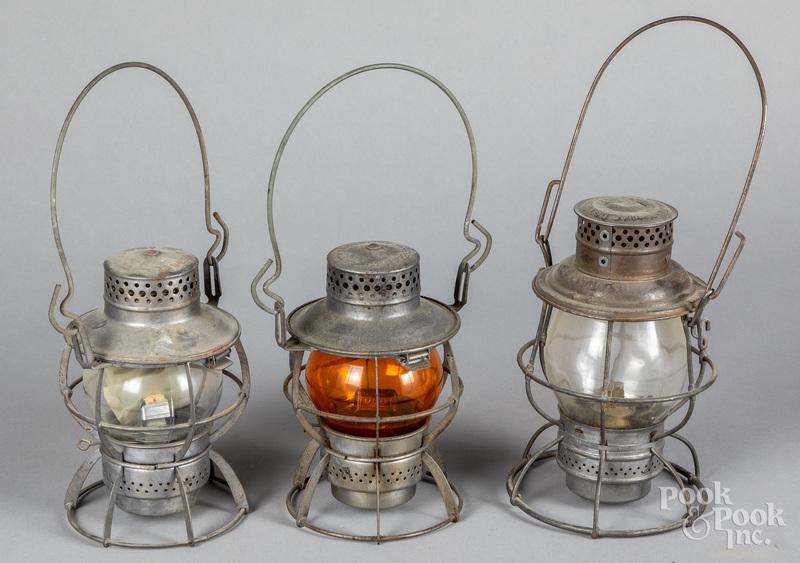 Three railroad lanterns, to include Adlake Reliab