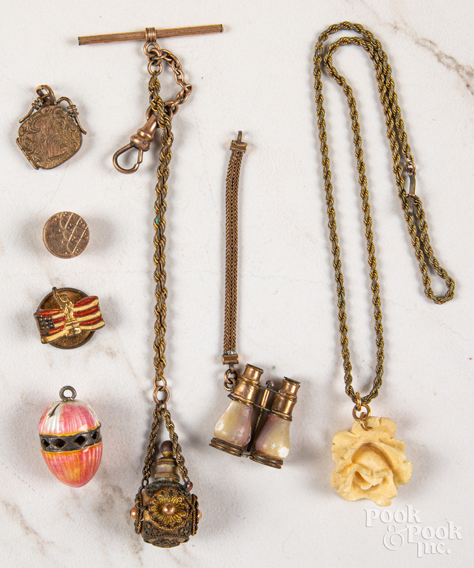 Group of gold and gold tone antique charms.