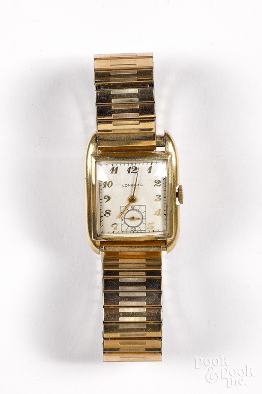 Longines 14K gold wrist watch.