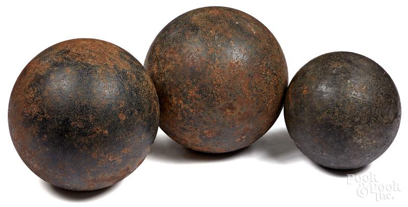 Three cast iron cannon balls