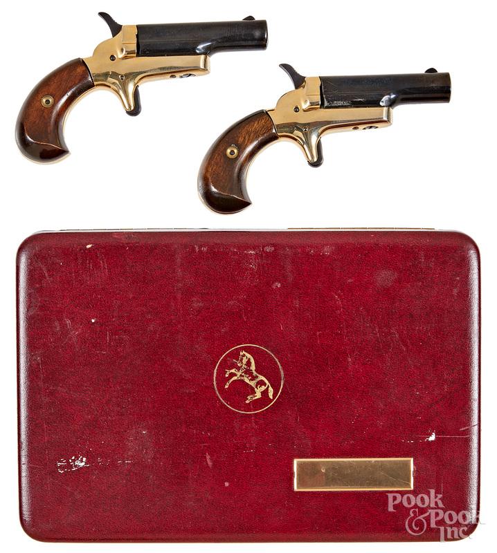 Pair of Colt single shot side lever pistols