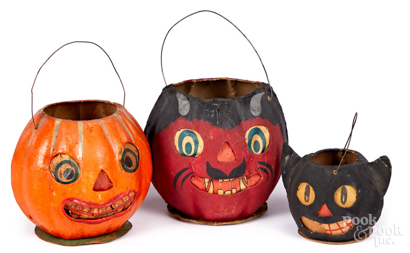 Three German pressed card Halloween lanterns