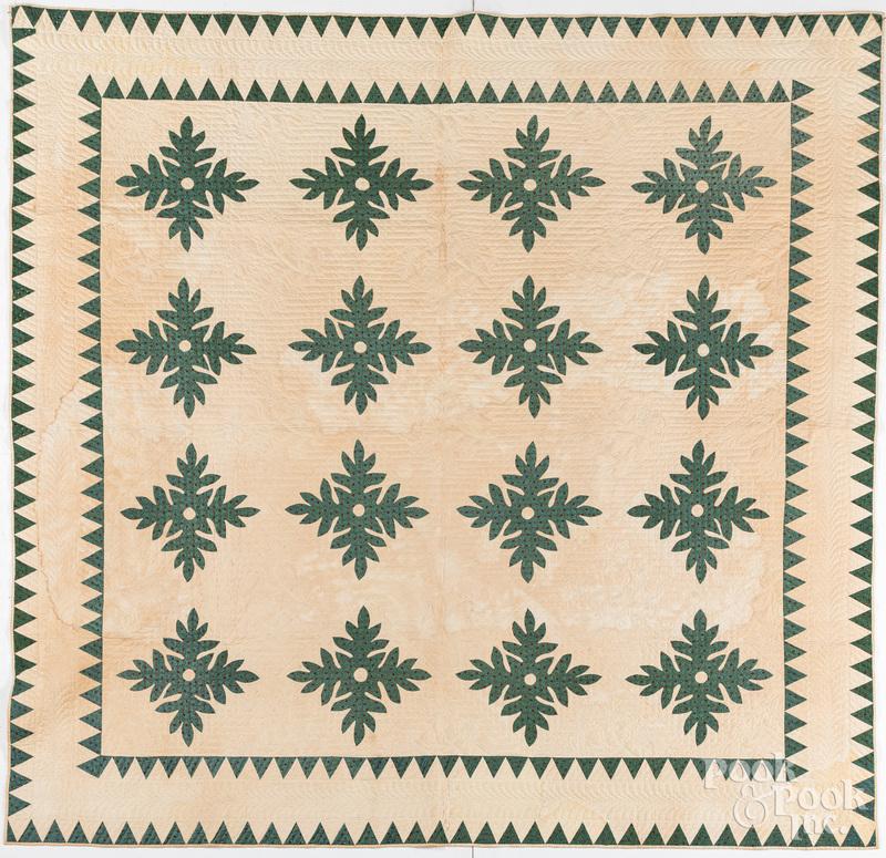 Green and white appliqué oak leaf quilt