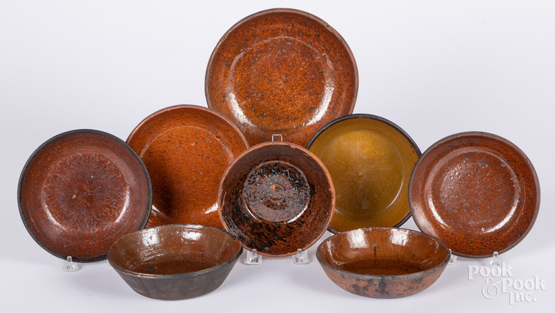 Eight redware shallow bowls, 19th c.