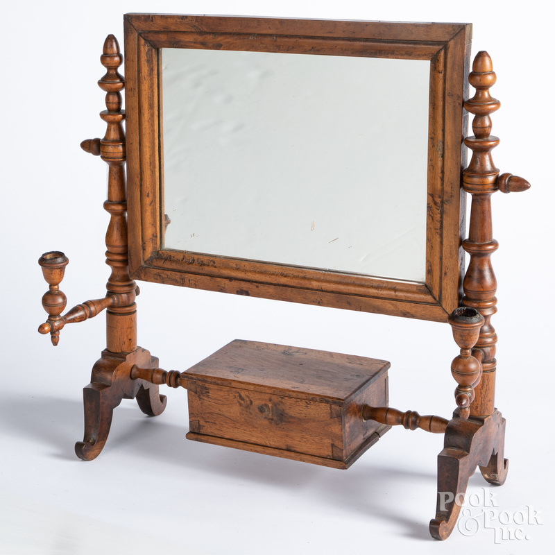 Walnut shaving mirror, 19th c., with candlearms