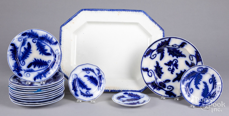 Fourteen flow blue plates, a shallow bowl