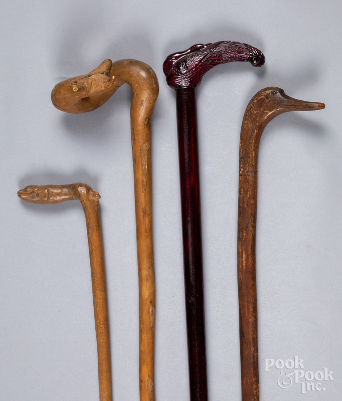 Four carved canes, with animal grips.