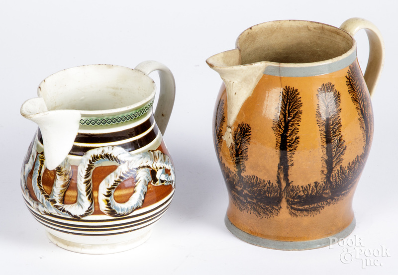 Two mocha pitchers
