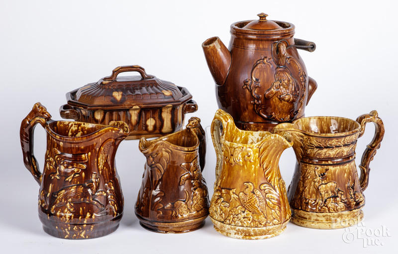 Four Rockingham pitchers, together with a jug