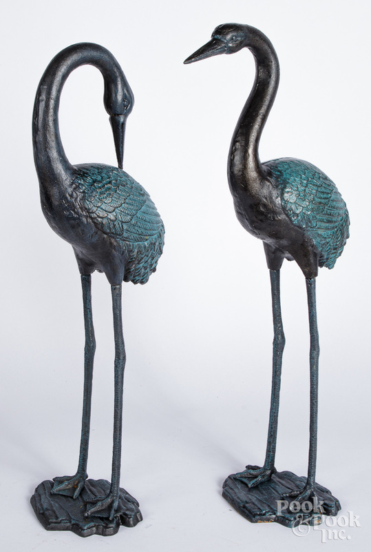 Pair of painted iron egret lawn ornaments.