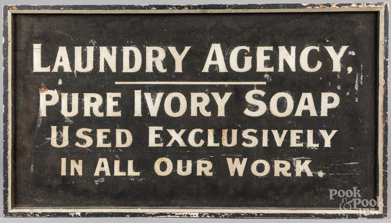 Painted Laundry Agency trade sign.