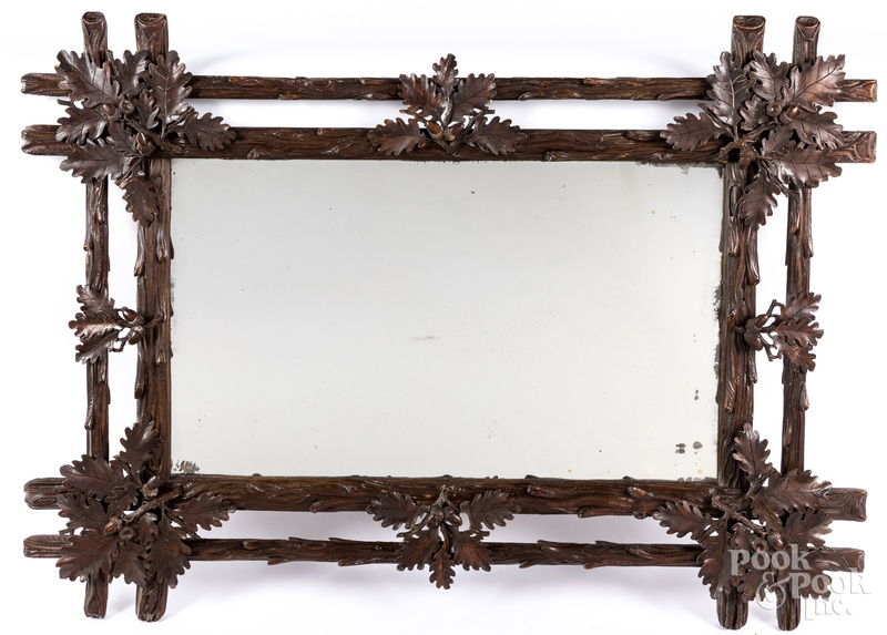 Black Forest carved oak leaf mirror.