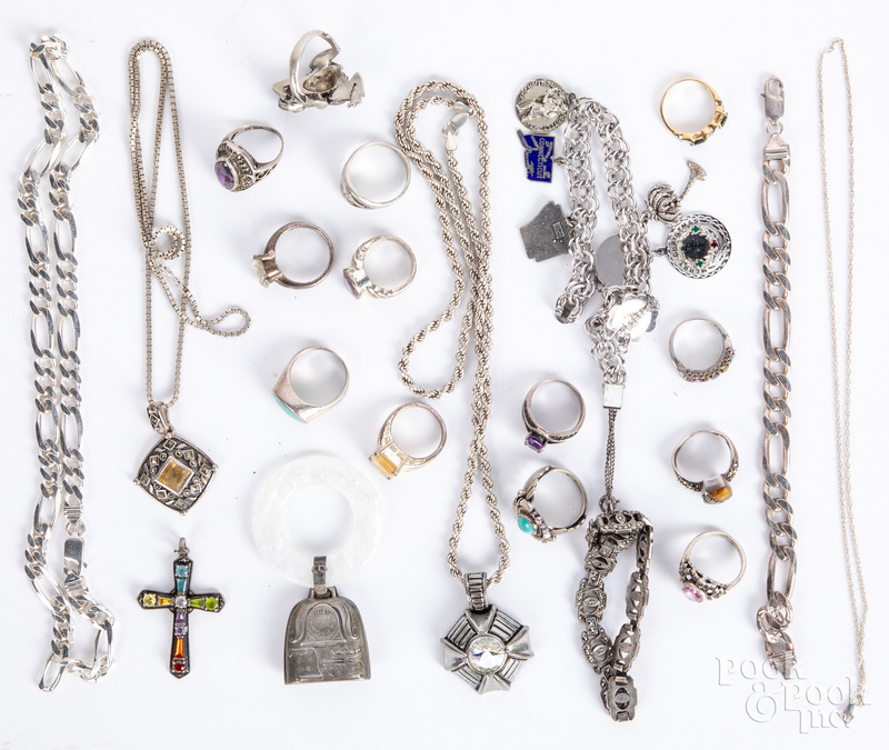 Group of mostly silver jewelry.