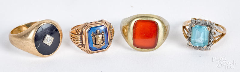 Four 10K gold and gemstone rings, 24.2 dwt.