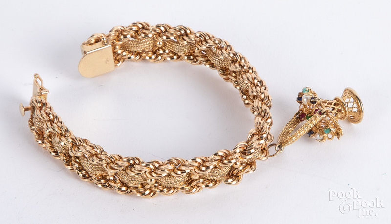 14K gold bracelet, with basket charm, 41.7 dwt.