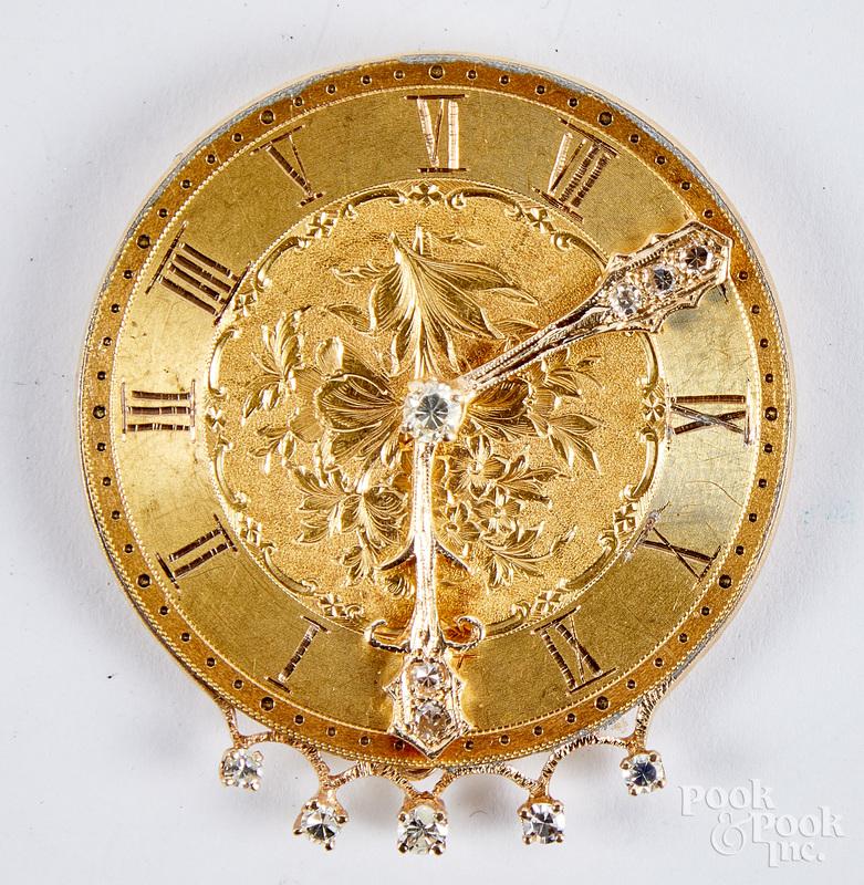 14K gold and diamond clock face brooch, 10.9 dwt.