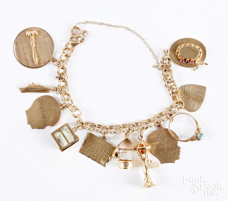 14K gold charm bracelet, 29.1 dwt.