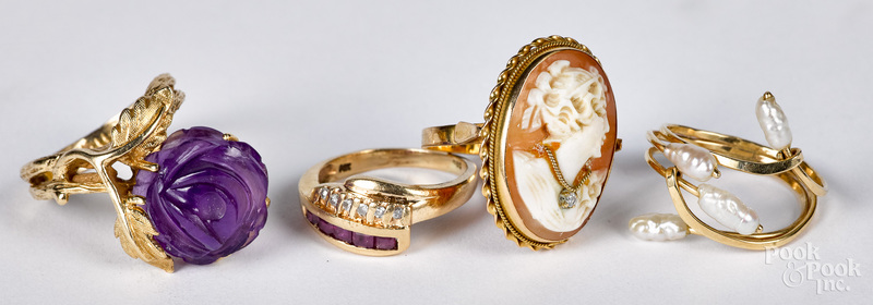 Four 14K gold and gemstone rings, 10.9 dwt.