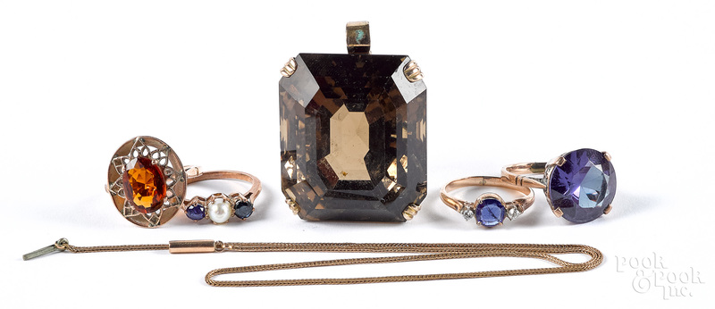 Four low grade gold and gemstone rings