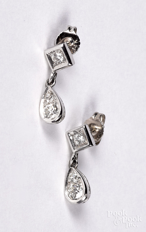 Pair of 14K white gold and diamond earrings