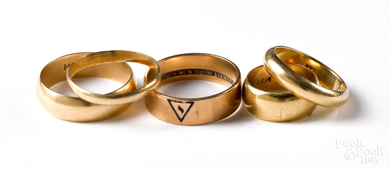 Five 14K yellow gold wedding bands